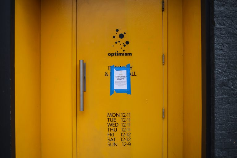 yellow metal door with blue and white sticker
